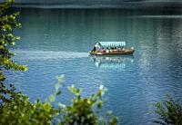 Lake Bled, Upper Cariola, Slovenia. Tourists enjoying excursion on the lake.