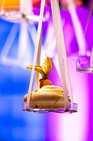 Merengues hanging from a lighted design cloud construction as a decor for the presentation of desserts, Strijp-S, Eindhoven, The Netherlands, Europe.