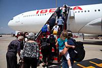 Travelers taking an Iberia flight at the time of COVID-19.