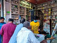 Sonauli, India - September 26 2020: People queued outside local chemist shop to purchase medicine during coronavirus pandemic.