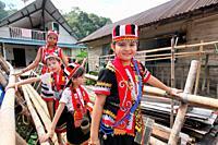 Celebrating Gawai with traditional costume at long house near kuching city, Sarawak, Malaysia