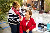 Using a stethoscope, a volunteer nurse give a fellow volunteer a free medical checkup at the charity food pantry of a Southern California Catholic chu...