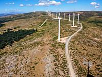 Aerial view of wind turbines for power generation. Concept eco clean energy production. Renewable energy.