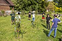 Detroit, Michigan - Members of the Morningside community organization participate in a bicycle tour of gardens in their east side neighborhood. The to...