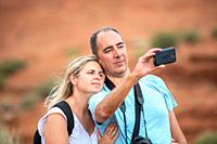 Happy couple taking selfie in the national park.