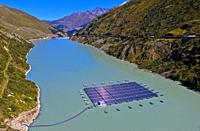 First high altitude floating solar power plant in Switzerland, Lac des Toules, Bourg-Saint-Pierre, Valais, Switzerland.