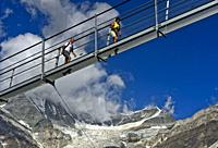 Hikers on the Charles Kuonen Suspension Bridge, Randa, Valais, Switzerland.
