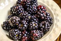 Blackberries (Rubus) waiting to be eaten from bowl, Fallston, MD.