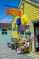 Colorful shop at restored 19th century working fishing village of Fisherman's Cove near Halifax, Nova Scotia, Canada.