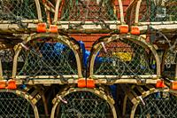 Lobster traps at restored 19th century working fishing village of Fisherman's Cove near Halifax, Nova Scotia, Canada.