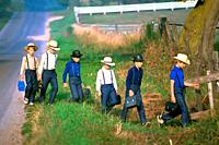 Amish boys walking to one room school with lunch buckets in hand - Shipshewana Indiana.