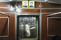 Pyongyang, North Korea, Asia - Commuters inside a subway train compartment of the Pyongyang Metro. The metro trains comprise of former West Berlin U-B...