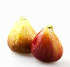 Close-Up Of Fig Against White Background.