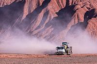 Truck in the eroded landscape of the Desierto del Diablo in the Los Colorados area, in the town of Tolar Grande in the province of Salta in La Puna Ar...