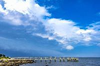 Storm Coming Beach Pier Buzzards Bay Ocean Padanaram Dartmouth Massachusetts New Bedford and Fort Rodman in distance.