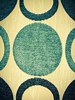 Close up of circular textile pattern.