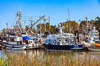 Pleasure craft and fishing boats docked in Steveston Paramount Harbour British Columbia Canada.