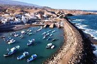 Aerial view of a little fishing town with some colorful boats in Tajao, Tenerife, Canary Islands. High quality photo.