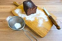 Homemade chocolate cake on a wooden board.