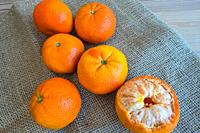 Tangerines on a wooden table.