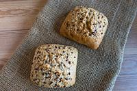 Small bread with seeds on a table.