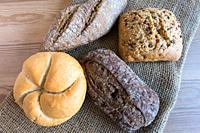 Different kinds of small bread on a table.