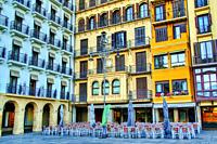 outdoor restaurant tables and chairs in Plaza del Castillo, Pamplona, Navarre Province, Spain.