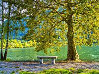 park bench beside Lago di Piano, near Porlezza, Como Province, Lombardo, Italy.