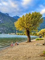 mother and child on a beach, Lake Lugano at Porlezza, Como Province, Lombardo, Italy.