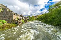 A swollen river Glaslyn making It's way towards It's meeting point with the river Colwyn at Beddgelert, North Wales UK. August 2020.
