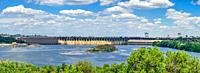 Zaporozhye, Ukraine 07. 20. 2020. Panoramic view of the Dnieper hydroelectric power station from the Khortytsya island in Zaporozhye, Ukraine, on a su...