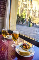 Two glasses of beer with tapa in a cafeteria. Segovia, Spain.