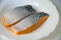 Two salmon loins in a dish.