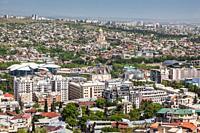 Georgia, Tbilisi, high angle city skyline from Mtatsminda Park with Tbilisi Public Service Hall and Tsminda Sameba Cathedral