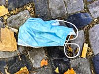 Berlin, Germany. Due to the Corona Crisis, people started wearing Facemasks that they loose in the streets after removal from their faces. The streets...