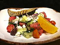 Greek salad with fruits and vegetables.