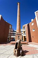 Chimney of industry in Portimao, Algarve, Portugal.