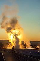 Clepsydra Geyser erupting at sunset, Lower Geyser Basin, Yellowstone National Park, Wyoming, USA.
