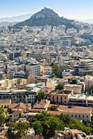 Athens, Attica, Greece. View over Athens from the Acropolis to 277 meter high Mount Lycabettus (Lycabettos or Lykabettos or Lykavittos) crowned by the...