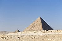 The pyramid of Menkaure next to the queen's pyramids, Giza, Egypt.