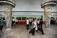 Pyongyang, North Korea, Asia - Commuters on an underground station platform with waiting subway train of the Pyongyang Metro in the North Korean capit...