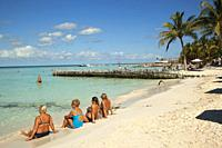 Tourists sunbathing at the sandy beach Playa Norte near the town center, Isla Mujeres, Cancun, Quintana Roo, Mexico, Central America.