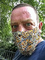 """Berlin, Germany. Sefie of a mature adult male with Corona Haridue wearing a """"""""protective"""""""" facemask."""