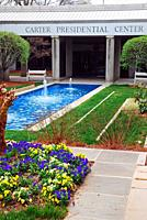 Flowers and fountains grace the entrance to the Jimmy Carter Presidential Library in Atlanta.