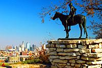 Scout, a local legend, watches over the skyline of Kansas City, Missouri.