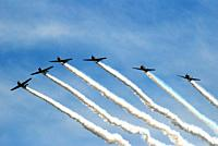 Stunt [pilots begin veering out of formation as they perform in an airshow.