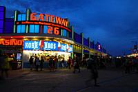 The businesses along the Boardwalk in Wildwood, New Jersey throws light on the summer crowd.