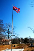 A confederate flag flies over the graves of fallen Civil War soldiers at the Marietta National Cemetery in Marietta Georgia.