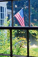 A vintage American flag hangs outside a historic home in Strawberry Banke, Portsmouth, New Hampshire.