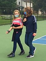 6th Grade Girls Walking Together and Wearing Masks, Wellsville, New York, USA.